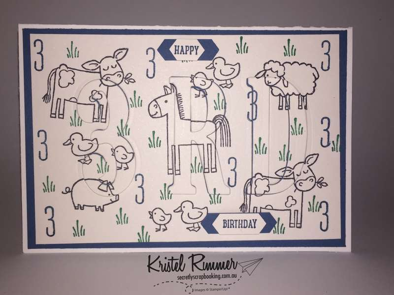 "6"" x 4"" Eclipse Card Closed with Barnyard Babies Stamp Set, Skinny Mini Alphabet Stamp Set, Thoughtful Banners Stamp Set, Large Letters Framelits, Large Number Framelits, Classic Label Punch, Dapper Denim, Whisper White and Emerald Envy (Stampin' Up!) - Secretly Scrapbooking (Bunbury, WA)"
